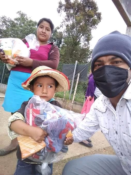 Student Steven giving food to a family